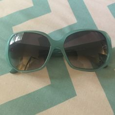 Authentic Teal Versace sunglasses Versus by Versace teal blue sunglasses.  Good condition, still a lotta life in them.  Slight scratches on the lens.  Please submit offers through offer button.... Thx and happy poshing Versace Accessories Glasses