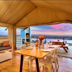 Dinner with a stunning view at AfriCamps at Stanford Hills. This beautiful glamping spot is situated on a boutique wine farm, just a 5 minute drive from central Stanford in the Western Cape. Tasting Room, Wine Tasting, Tent Camping, Glamping, Dining Area, Dining Table, Restaurant Names, Stunning View, Beautiful