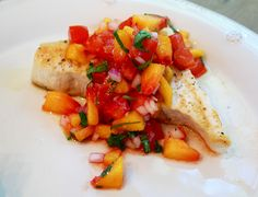 Grilled Swordfish With Peach Salsa  2 swordfish steaks  Salt & pepper    1 large fresh peach, peeled & diced  1 large tomato, cored, seeded & diced  1/4 cup red onion, finely chopped  1 large clove of garlic, finely chopped  4 tablespoons fresh cilantro, chopped  Juice of one fresh lime    Grill: med/high heat. Season fish with salt & pepper. Grill.  Combine peach, tomato, onion, garlic, cilantro & lime juice. Refrigerate.  Allow flavors to meld.  Top swordfish with salsa & serve.