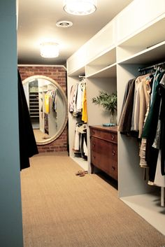 I love the mix of brick, painted wood, and antique furniture in this closet.