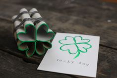 toilet paper roll four leaf clover shamrock stamp ...I'm thinking fancy duct tape would be just a nice. (Am I the only one without a glue gun handy?)