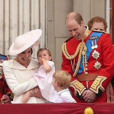 Happy Family: Prince William and Duchess Catherine laughing with Prince George (age 3) and Princess Charlotte (age 1) on the balcony at Buckingham Palace, June 2016