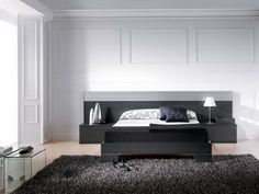 Love the dark wood and storage ideas