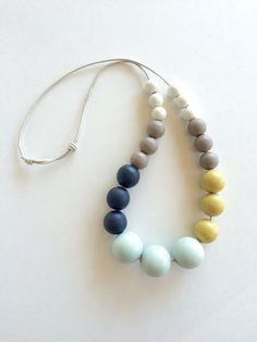 A series of hand painted round wooden beads in a totally mod color combo of MINT, MUSTARD, NAVY, TAUPE GREY, and CREAM. Necklace is strung on a PALE
