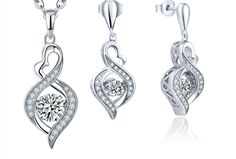 WIN THIS BEAUTIFUL   TOPAZ NECKLACE AND EARRING SET VALUED AT $250