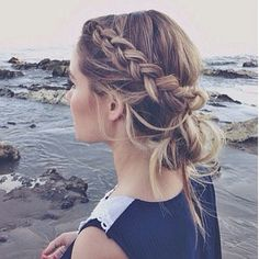 Tame your hair in style. This french braid leading into a messy bun does just that.