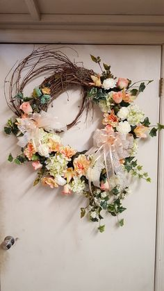 Cream, green and peach grapevine wreath by Lisa Hisaw
