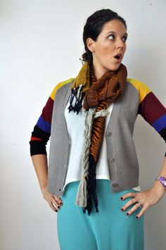 Handwoven scarf with extra long braid. Lots of fun color and texture in this one of a kind statement scarf by Amber Kane.