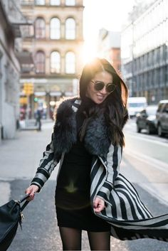 Golden Hour in NYC! Elevating the classic little black dress by adding patterns and textures. Pairing my favorite winter piece, a striped coat with a shearling vest and studded boots.