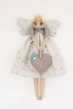 Fairy angel doll in grey and blue shades with little roses fabric and wool heart Doll Crafts, Diy Doll, Softies, Christmas Angels, Christmas Crafts, Spring Fairy, Angel Crafts, Sewing Dolls, Waldorf Dolls