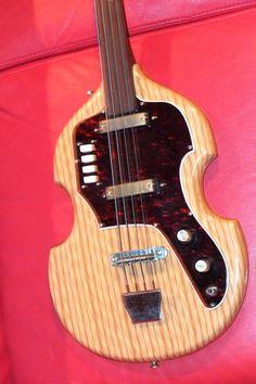 Vintage 1960s Eko Fretless Bass Guitar Scroll Headstock Pearloid Plastic Coated