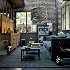 great style for a guys dorm room. colors, furniture. love the lighting.
