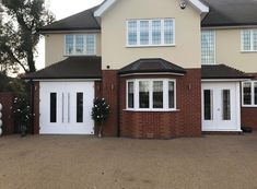 Modern side hinged garage door with a security front door to match. Side Hinged Garage Doors, Roller Shutters, Security Door, Entrance Doors, Home Photo, Shed, Outdoor Structures, London, Outdoor Decor