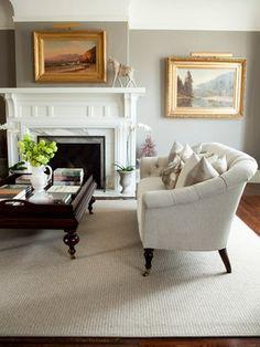 Fireplace, moulding, color scheme = calm & elegant living room
