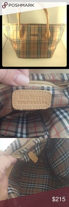 Burberry small handbag This handbag is new without tags. It measures 14x7 and is an older model. For those who are wondering why it's called burberrys and not b urberry I have included a description in the photos. Burberry Bags Mini Bags
