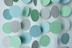 Blue Green and Gray Paper Garland Baby by FabulouslyHomemade would love to this with mini dinosaurs