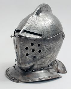MEDIEVAL STYLE ENGRAVED STEEL ARMOR HELMET   Engraved with paired eagles and foliate scrollwork. 12 3/4 x 10 x 12 1/2 in.   Estate of W. Roger Tyszkiewicz