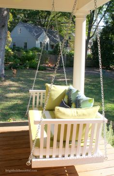 I love this large porch swing on the back covered deck  | Fall House Tour | Bright Bold and Beautiful