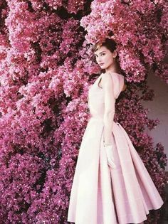 Audrey Hepburn, beauty icon choice from Stemology user Debra Simeroth. | fifties | pink flowers | pink dress | celebrity beauty | iconic beauty | hollywood legends