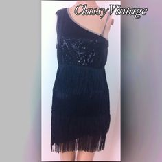 One shoulder flapper dress Black one shoulder flapper style dress. Sequined lined dress with three layers of tassels. Gently used. Tag Size standard . Bust 34 with some give , waist 28 and hips 34. Forum novelties Dresses