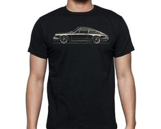 The Curb Shop - Curb 1973 911 T-Shirt  A great gift for the Porsche 911 guy in your life!  This shirt features a slick side view illustration of a 1973 Porsche 911 by Stuart Macey. It's 100% Made in America, 100% Cotton, and 100% Awesome.