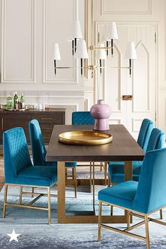 Modern with a touch of glam! This dining room set is *the* perfect focal point to break up a large space, like an open-concept home. The pop of blue in the chairs and sleek edges of the table make it so inviting — shop it all on macys.com!