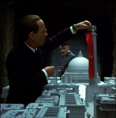Approximately thirty structures were built out of wood and styrene plastic.  Designs for the Germania model seen in The Empty Mirror were taken directly from the original plans drawn up by Hitler's Architect, Albert Speer. Hitler, a student of architecture, planned to transform Berlin into the world's most impressive city.
