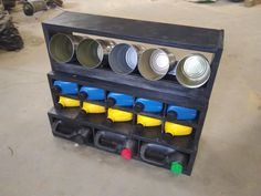 Turn some jugs and cans from the trash into a small parts shop organizer.