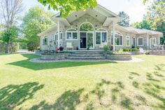 LUXURY WATERFRONT BUNGALOW This rare luxury bungalow located in Constance Bay enjoys sunset views over the tranquil waters of Buckham's Bay. Stunning architectural details include wall to wall windows for sweeping views of the water. Spacious open concept layout makes a fabulous entertaining space. High end finishes throughout create an executive feel. Attached 3 bay garage has one bay re-purposed as home office currently. This private property includes the adjacent lot for a combined…