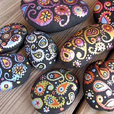 Painted Paisley stones make beautiful decorations in your garden or potted plants, or even on your desk as a paper weight!