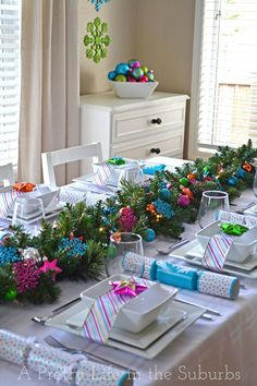 Colorful Christmas Table Idea. See 10 gorgeous holiday table ideas on www.prettymyparty.com.