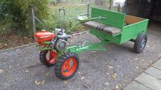 IMT 506 , two wheel tractor with custom trailer .