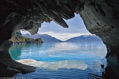 The marble cathedral of Chile: Are these the world's most beautiful caves? Welcome to the Marble Cathedral - a natural wonder that could be the world's most beautiful cave network. An azure temple created by nature, the walls of this network of water-filled marble caverns show just how magnificent the precious geography of our planet can be. Visitors to the water-sculpted blue caverns see light reflected off the turquoise waters of South America's second largest freshwater lake, Genera...