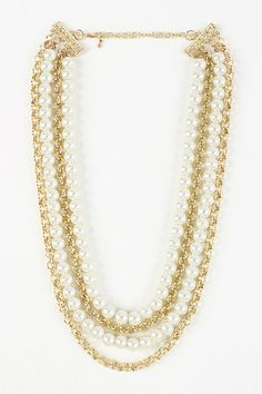 Add a little something extra to your look with the Rolo and Pearl Necklace. This necklace features rolo chain and faux pearls finished with lobster claw closure. Lead and nickel free.
