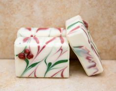 Winter is my favorite season. A wonderful crispness to the air and a snowy landscape instills in us anticipation for the days to come. Beautiful holiday decorations, a crackling fire to gather around and the wonderful scent of the holly and berries that fill the vases. And so I created this soap in celebration of this joyous season.    This is a limited edition soap and not included in any sale or trial packs.     The colors are for the winter snowy landscape, the Christmas greenery and the…