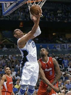 Orlando Magic's Gustavo Ayon (19), of Mexico, makes a shot in front of Los Angeles Clippers' DeAndre Jordan (6) during the first half of an NBA basketball game, Wednesday, Feb. 6, 2013, in Orlando, Fla