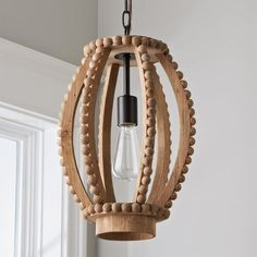 Check out Boho Wood Beaded Pendant - Large from Shades of Light Vintage-inspired, with oversized bead detailing and a distressed finish, this wood lantern looks like an authentic found object picked up in distant travels. Farmhouse Pendant Lighting, Wood Pendant Light, Contemporary Pendant Lights, Chandelier Pendant Lights, Lantern Pendant, Wire Pendant, Sconce Lighting, Hanging Light Fixtures, Light Shades