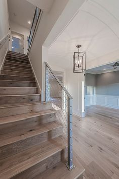 Barrel Ceiling Foyer with steel cable railing staircase and wide plank oak floors. Floor is Chesapeake Flooring White Oak, Provence Manor Outback. barrel-ceiling-foyer-with-stainless-cable-railing-staircase-and-wide-plank-oak-floors Cottage Home Company Waterproof Laminate Flooring, House Ideas, Coastal Living Rooms, Basement Remodeling, Basement Ideas, Basement Kitchen, Basement Colors, Basement Makeover, Basement Bathroom