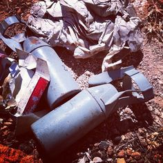 Cluster submunitions in trash heap by side of road. Syria. Early this week, on the drive in.