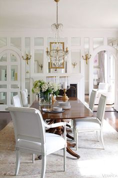 white dining room with dark table