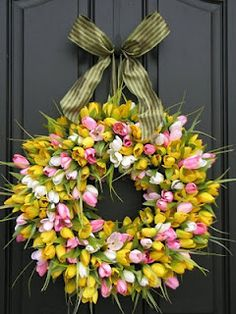 We can't wait for spring! How fabulous would this look on your door? #Spring #Tulip #Wreath