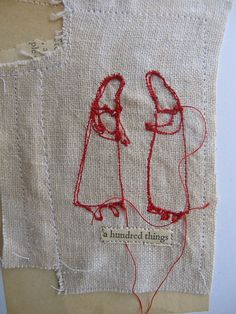 Cathy Cullis. I own a number of her wonderful stitched pieces.