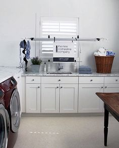 The new clothesline company - suspended drying rack for laundry room