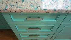 Floating Blue Vetrazzo and Teal Cabinetry  Love these colors!!!!!
