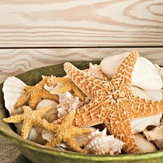 This beautiful array of sand dollars, seashells, and starfish instantly and inexpensively adds an organic accent to the room. Ocean treasures can also be arranged in oversize glass vases and set upon a mantel for a coastal focal point in a family room.