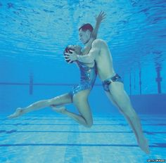 Bill May and Kristina Lum in the water in 1998. Why can't men be Olympic synchronised swimmers?