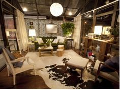 Emily Henderson's winning Design Star challenge! She always has a crazy couch!  Love the wallpaper...