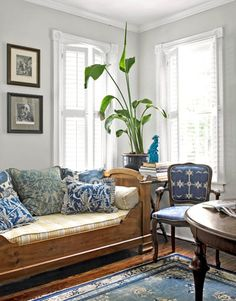 """As for the furnishings, """"I really played with different patterns,"""" McCarty says, explaining that it works because the palette is limited to blue and white. A grouping of Art Deco Chinese rugs echoes the charmingly mismatched pillows and vintage chairs, as well as a collection of similarly hued English transferware."""