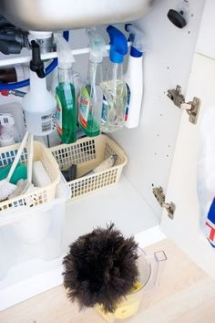 Use Tension Rod to Hang Spray Bottles Under Your Sink. - Top 58 Most Creative Home-Organizing Ideas and DIY Projects