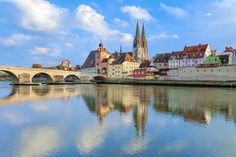 View from Danube on Regensburg Cathedral and Stone Bridge in Regensburg, Germany | © Mikhail Markovskiy/Shutterstock